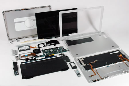 mac disassembled for liquid spill repair